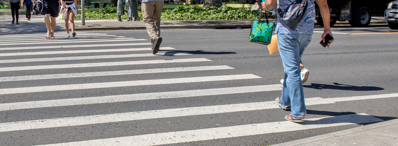 People crossing the street at crosswalk