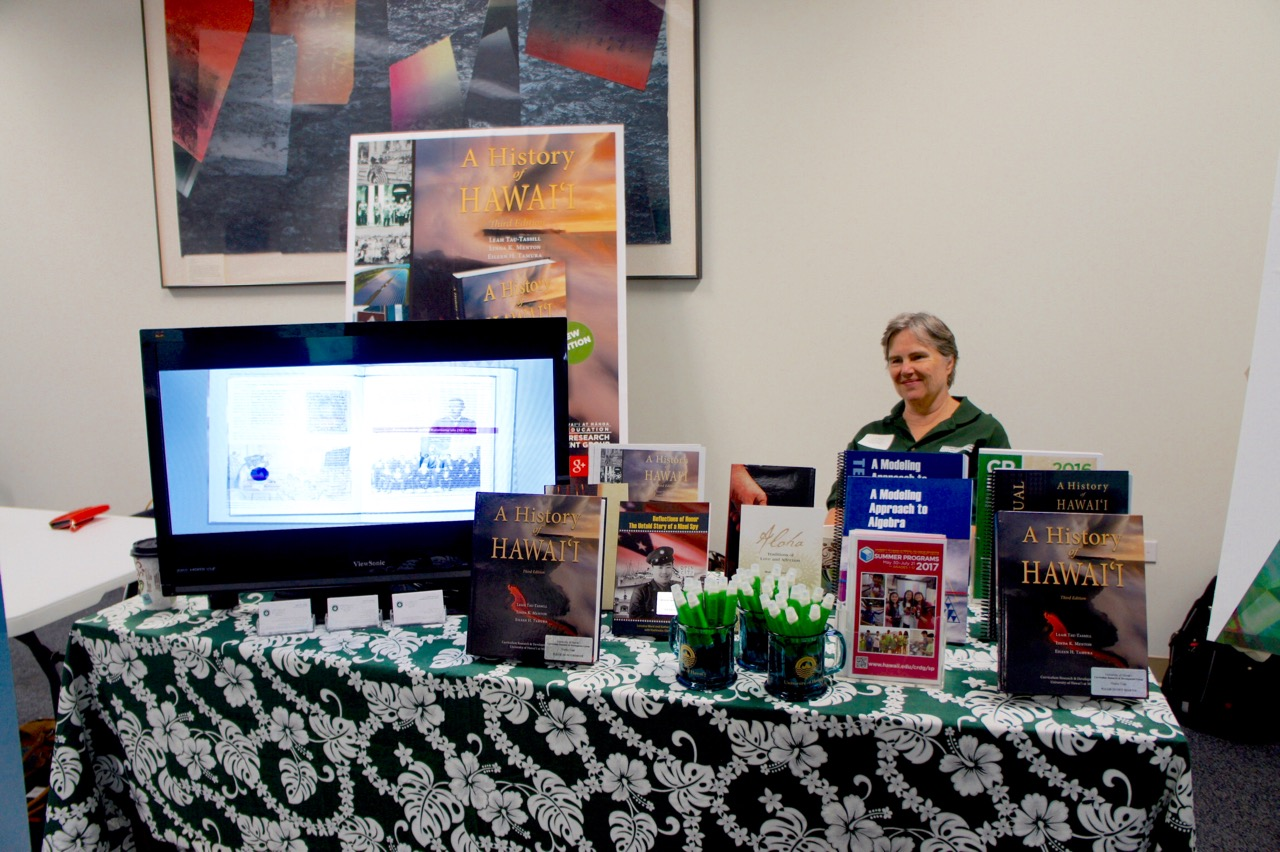 Lori Ward behind CRDG's display table