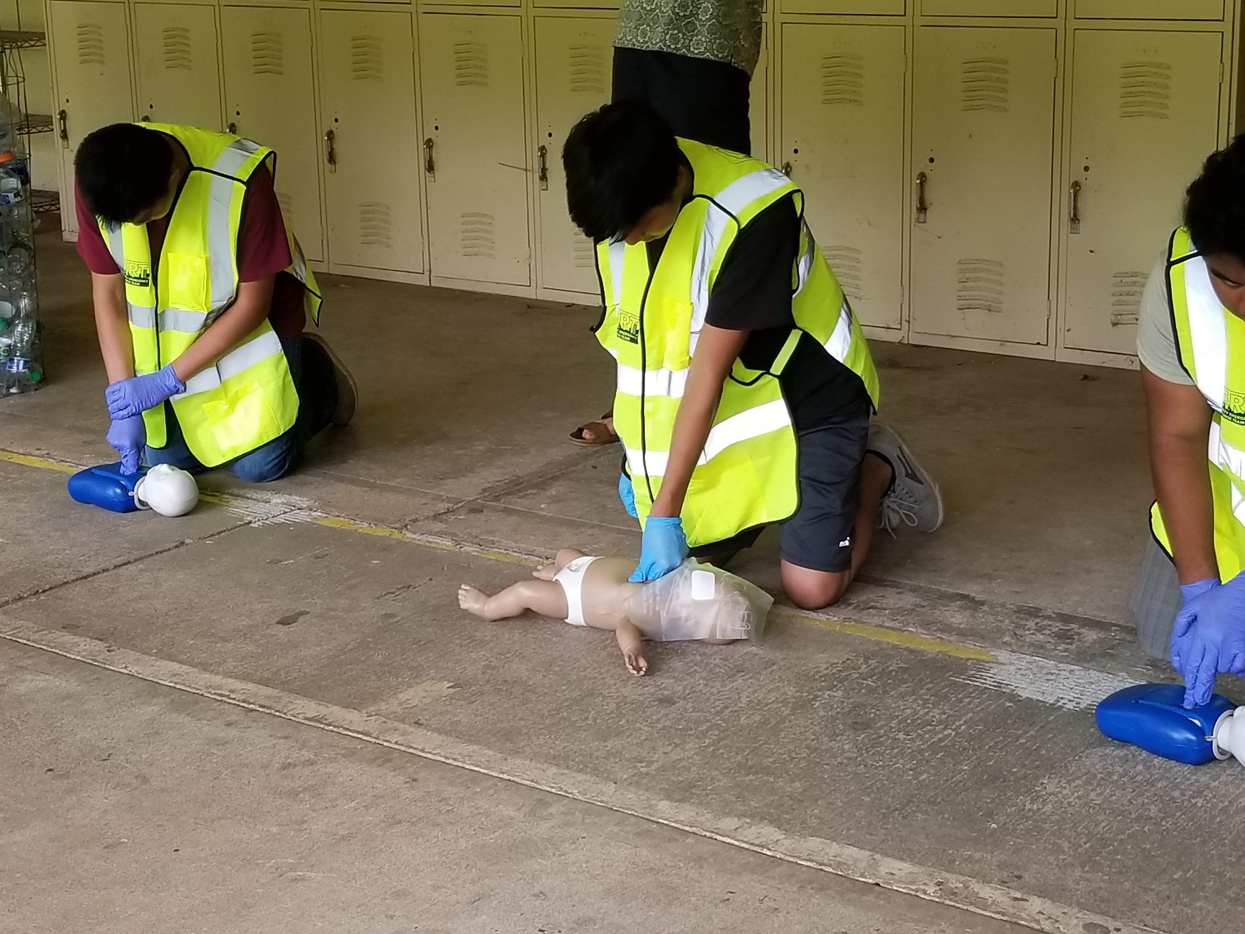 High School Jr. ROTC Cadets learning CPR
