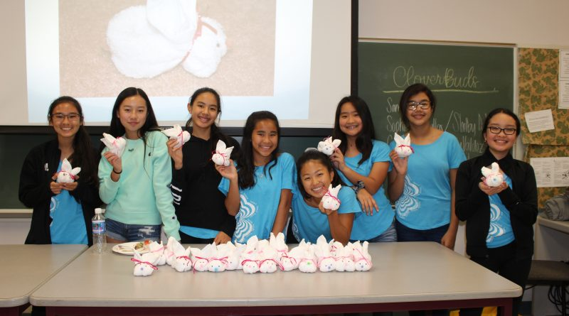 Club members showing washcloth bunnies they made for community service project.