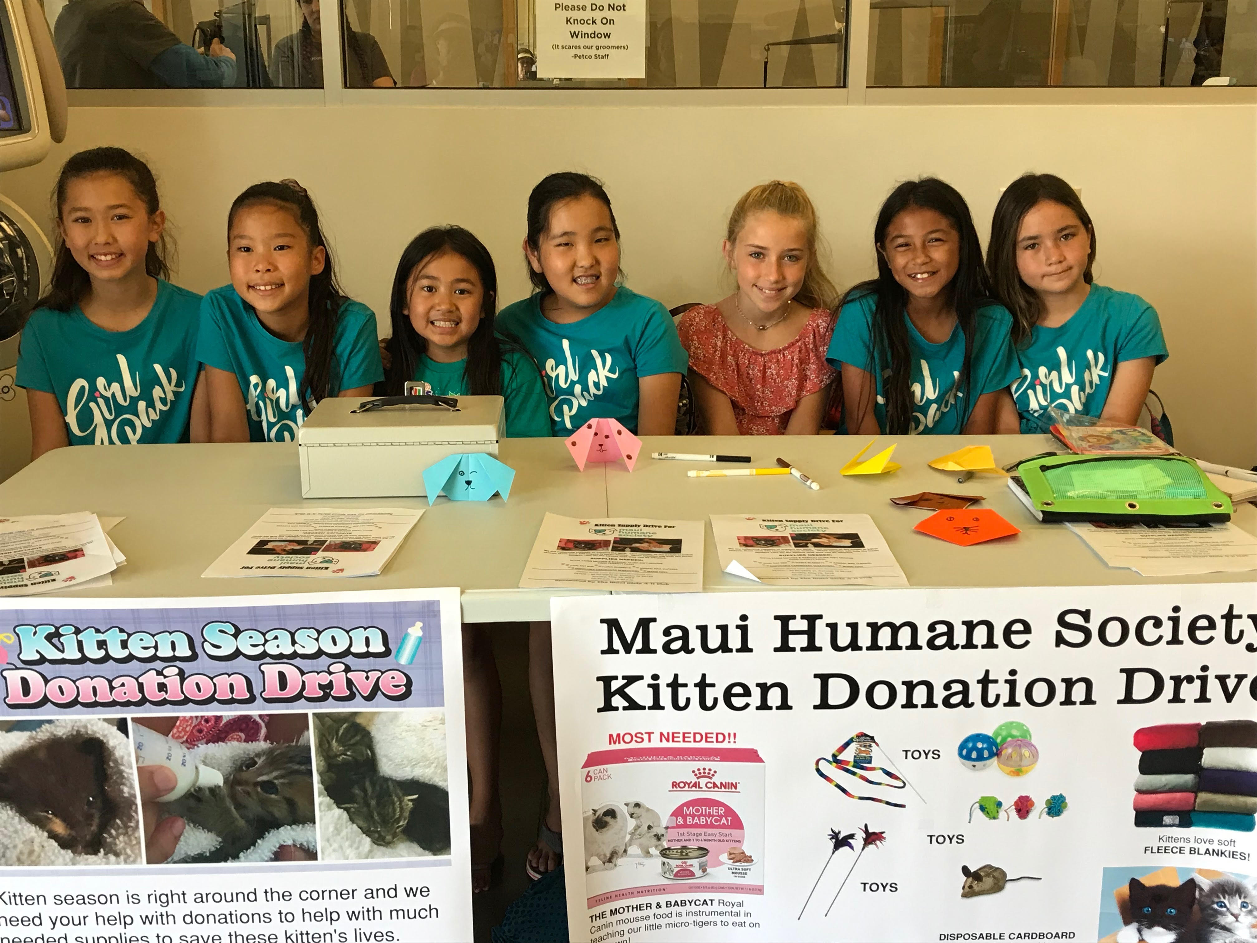 Maui Girl club members hosting a donation table at Petco