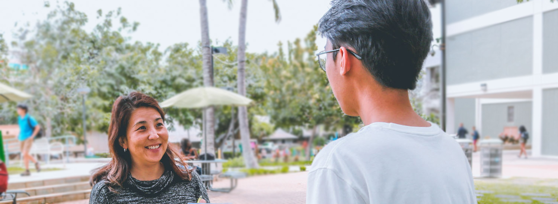 student talking to staff
