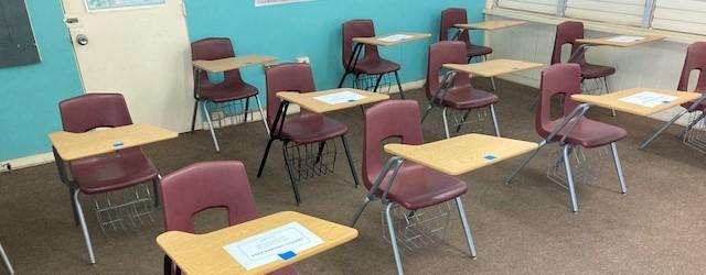 classroom desks arranged for social distancing
