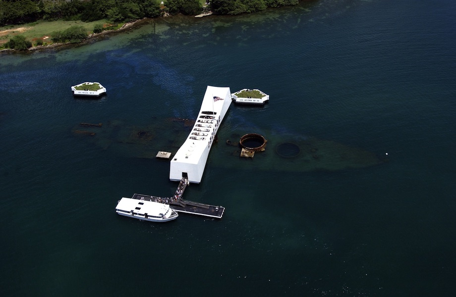 <p><strong>Fig. 1.18.</strong> The USS Arizona and its memorial, located at Pearl Harbor in Honolulu, Hawai&lsquo;i, marks the resting place of sailors killed on December 7, 1941 from a surprise Japanese aerial attack.</p>