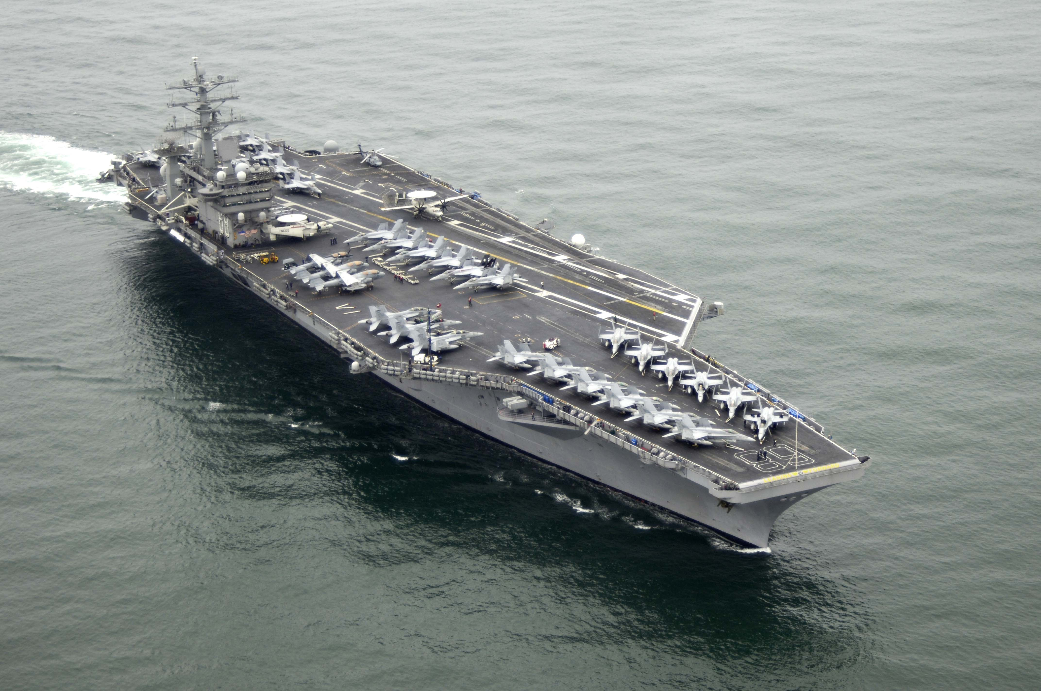 <p><strong>SF Fig. 2.4.</strong> A U.S. Navy Nimitz-class aircraft carrier floating at sea.</p>