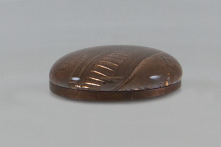 <p><strong>Fig. 3-11:&nbsp; </strong>Water piled on top of a penny showing surface tension caused by the cohesive property of water and hydrogen bonding</p>