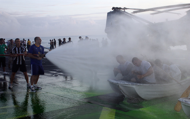 """<p><strong>SF Fig. 3.1.</strong> (<strong>B</strong>) The act of """"crossing the line"""" across the equator has become a celebratory rite of passage in recent years, as sailors are doused with water aboard the <em>USS New Orleans</em>.</p>"""