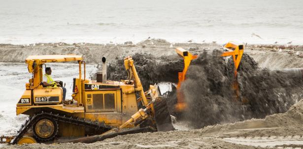 <p><strong>Fig. 2.24.</strong> The U.S. Army Corps of Engineers replenishes an Atlantic City beach with sand dredged from the ocean after the beach was eroded by Hurricane Sandy in the fall of 2012.</p><br />