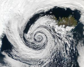 <p><strong>Fig. 3.9.</strong> (<strong>A</strong>) A low-pressure system spiraling counter-clockwise over Iceland in the Northern Hemisphere.</p><br />