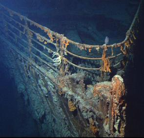 <p><strong>Fig. 9.30.</strong> (<strong>B</strong>) The <em>RMS Titanic</em> has been explored using submersible vehicles. This photo of the <em>RMS Titanic</em> was taken by the ROV <em>Hercules</em> at a depth of approximately 12,500 feet.</p><br />
