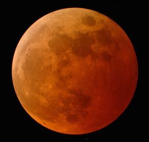 <p><strong>SF Fig. 6.6. </strong>Picture of a total lunar eclipse as the moon enters the earth's umbra dark shadow.</p>