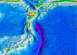 <p><strong>Fig. 7.28.</strong> In this computer model of the ocean floor north of Puerto Rico, Caribbean Sea, western central Atlantic ocean basin, the purple areas indicate the Puerto Rico Trench, 8.6 km below the ocean surface. It is the deepest point in the Atlantic ocean basin.</p><br />