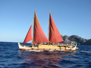 <p><strong>Fig. 8.3.</strong> The Polynesian voyaging canoe <em>Hōkūle'a</em> sails near Nihoa in the Papahānaumokuākea Marine National Monument, Northwestern Hawaiian Islands.</p><br />