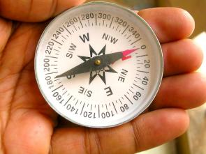 <p><strong>Fig. 8.9.</strong> A magnetic compass points to the earth's magnetic North.</p><br />