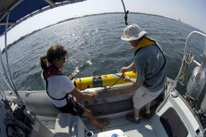 <p><strong>Fig. 2.9.</strong> Ocean engineers Amy Kukulya and Tom Austin prepare to launch an Autonomous Underwater Vehicle (AUV), which conducts rapid environmental surveys and can detect underwater mines.</p><br />