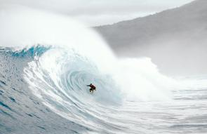 <p><strong>SF Fig 4.6.1.</strong> A crouching surfer on a breaking wave in Mexico, illustrating why it can be difficult to agree on wave size</p>