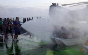 "<p><strong>SF Fig. 3.1.</strong> (<strong>B</strong>) The act of ""crossing the line"" across the equator has become a celebratory rite of passage in recent years, as sailors are doused with water aboard the <em>USS New Orleans</em>.</p><br />"