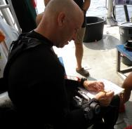 <p><strong>Fig. 2.7. </strong>(<strong>C</strong>) A research diver plans a dive.</p><br />