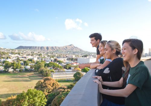 Students On Campus With Diamondhead In Background