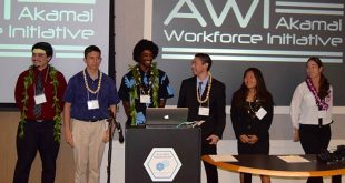 Akamai interns around podium