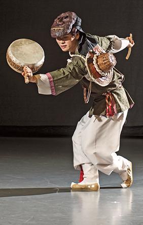 Korean mask dance performer