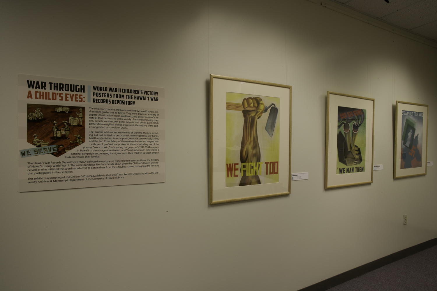 """Images of the """"War through a Child's Eye's: World War II Children's Victory Posters from the Hawaii War Records Depository"""" Exhibit."""