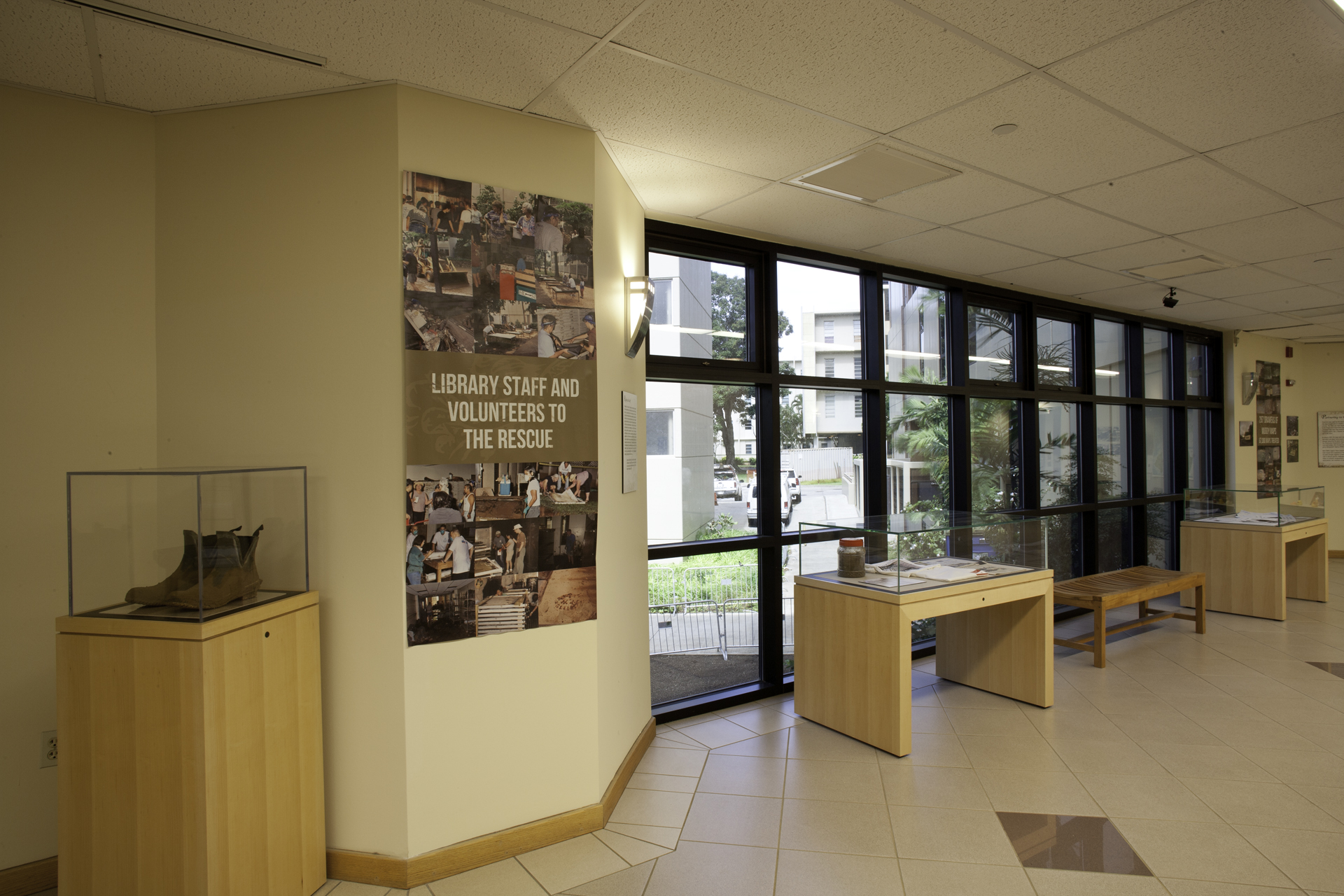 "In-situ photographs of the ""Finding the Silver Lining of the Manoa Flood"" exhibit in the Bridge Gallery."