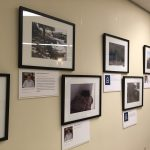 First set of framed photos of people and neighborhoods