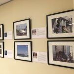 Second set of framed photos of people and neighborhoods