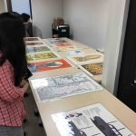pacific ephemera posters laid out on tables