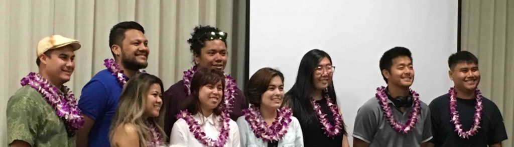 Video shorts winners wearing leis pose for a photo.