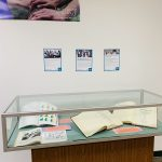 Books in display case for Census 2020: ALL in for a Better Hawaii exhibit