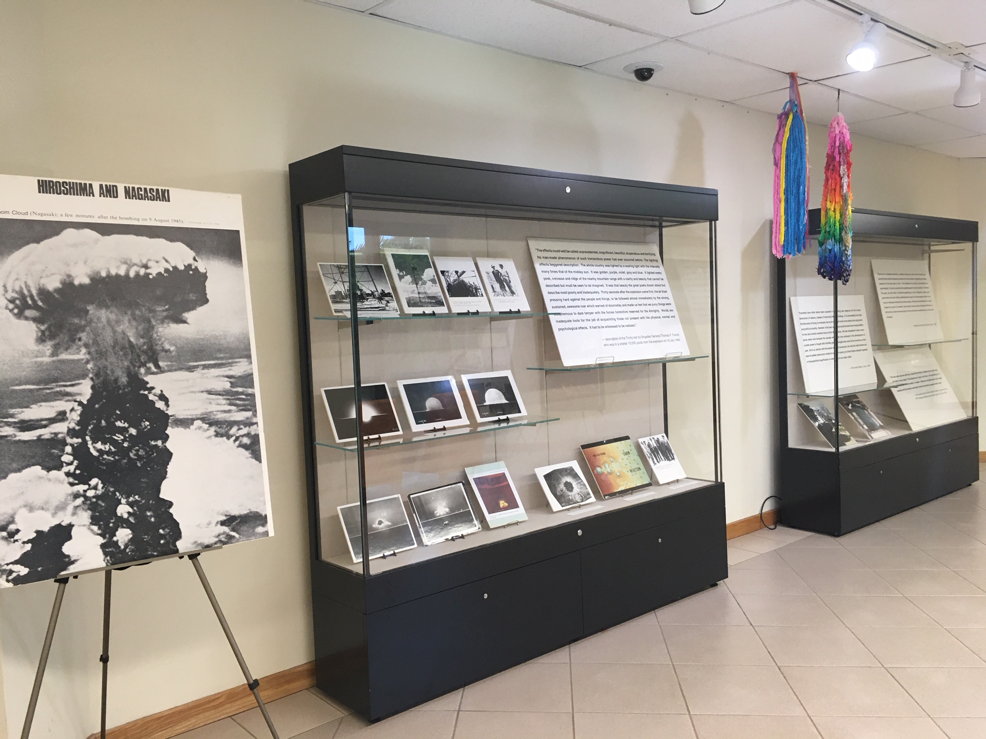 Display cases and poster for Beginning and End of the Bomb Exhibit