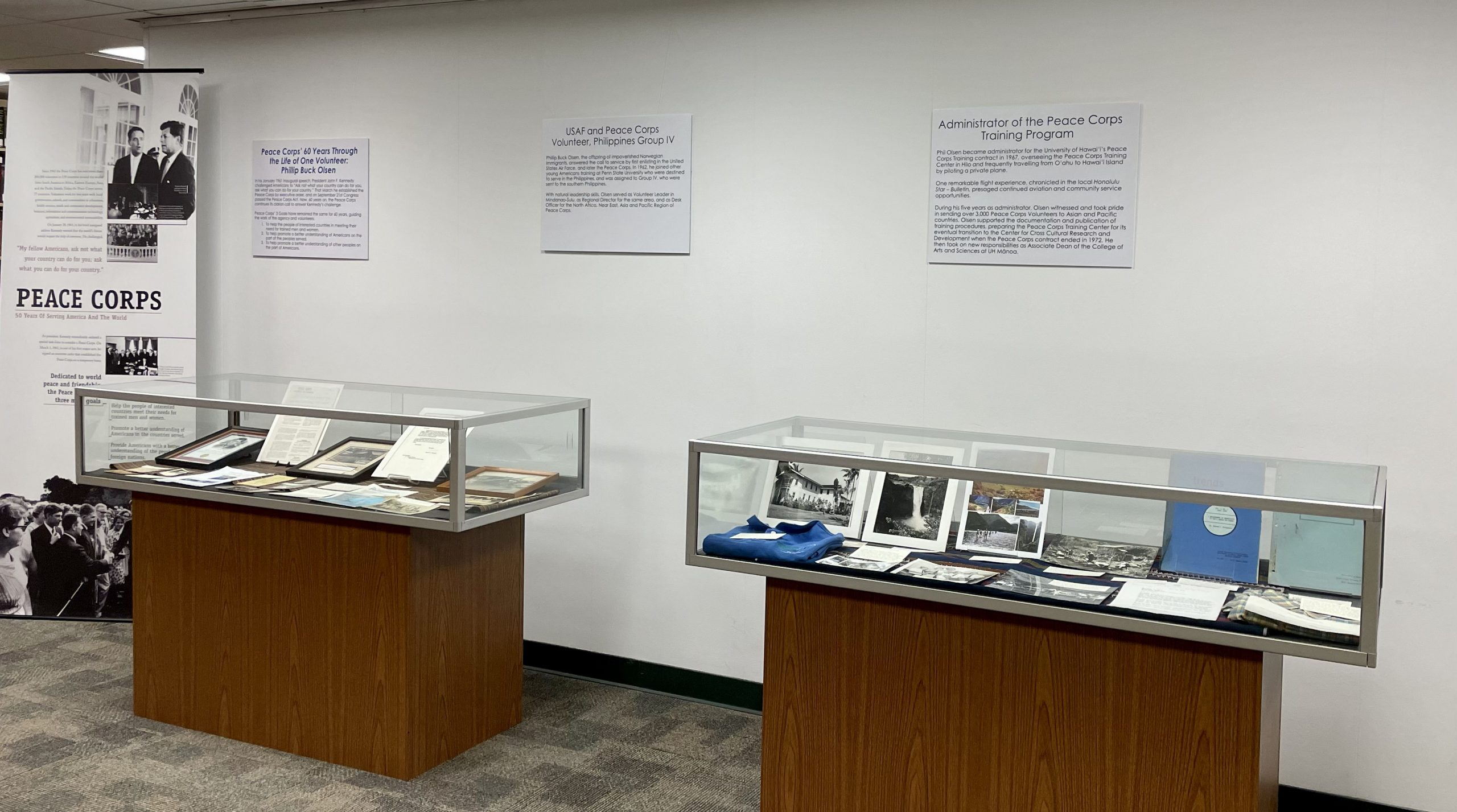 Peace Corps exhibit two display cases with images and texts 1 of 6