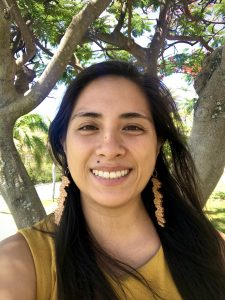 Color headshot of Romyn Kim Sabatchi smiling at camera while outside.