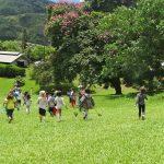 Children running across a lawn