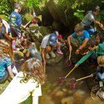 Children fish with handheld nets