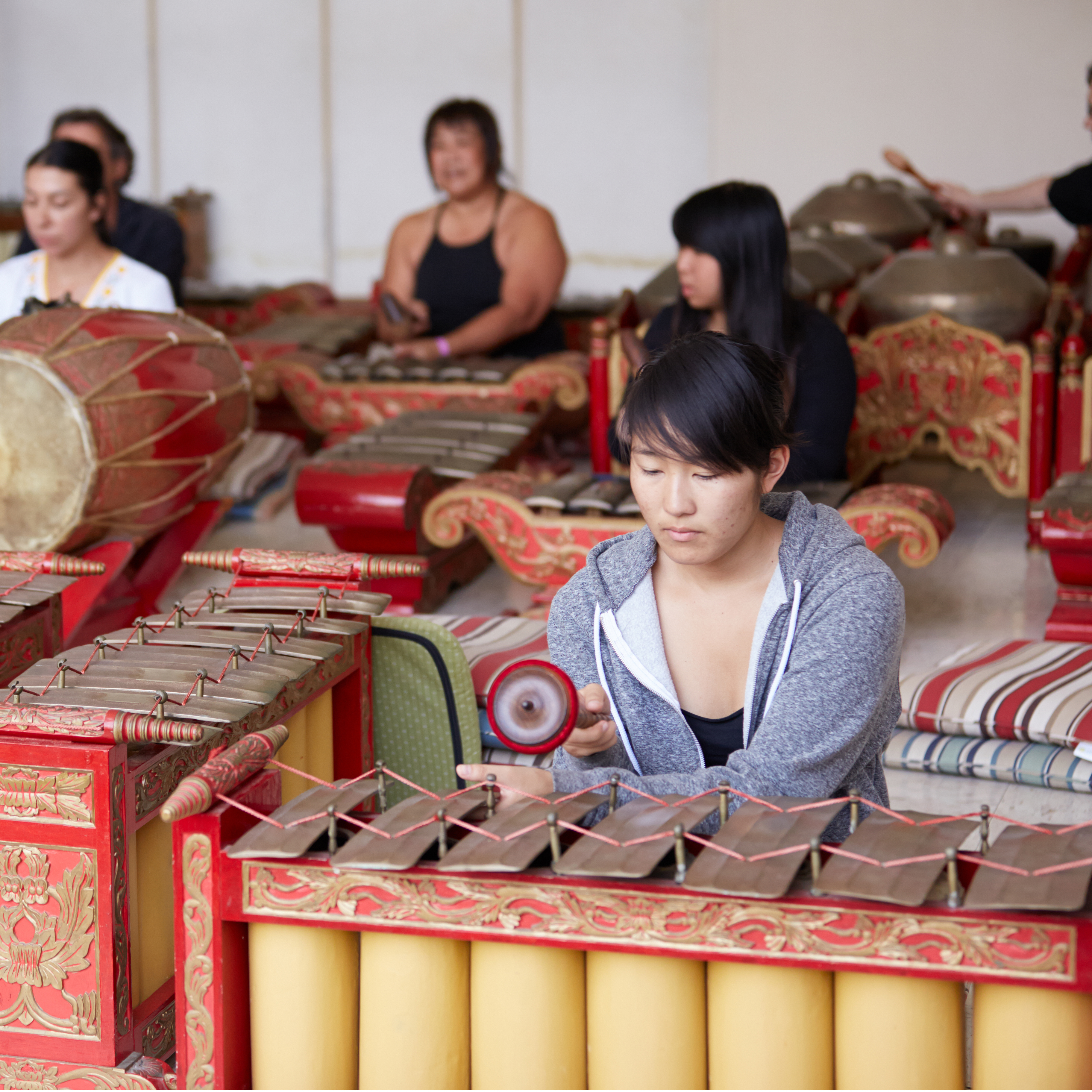 Student playing the UH Mānoa Gamelan