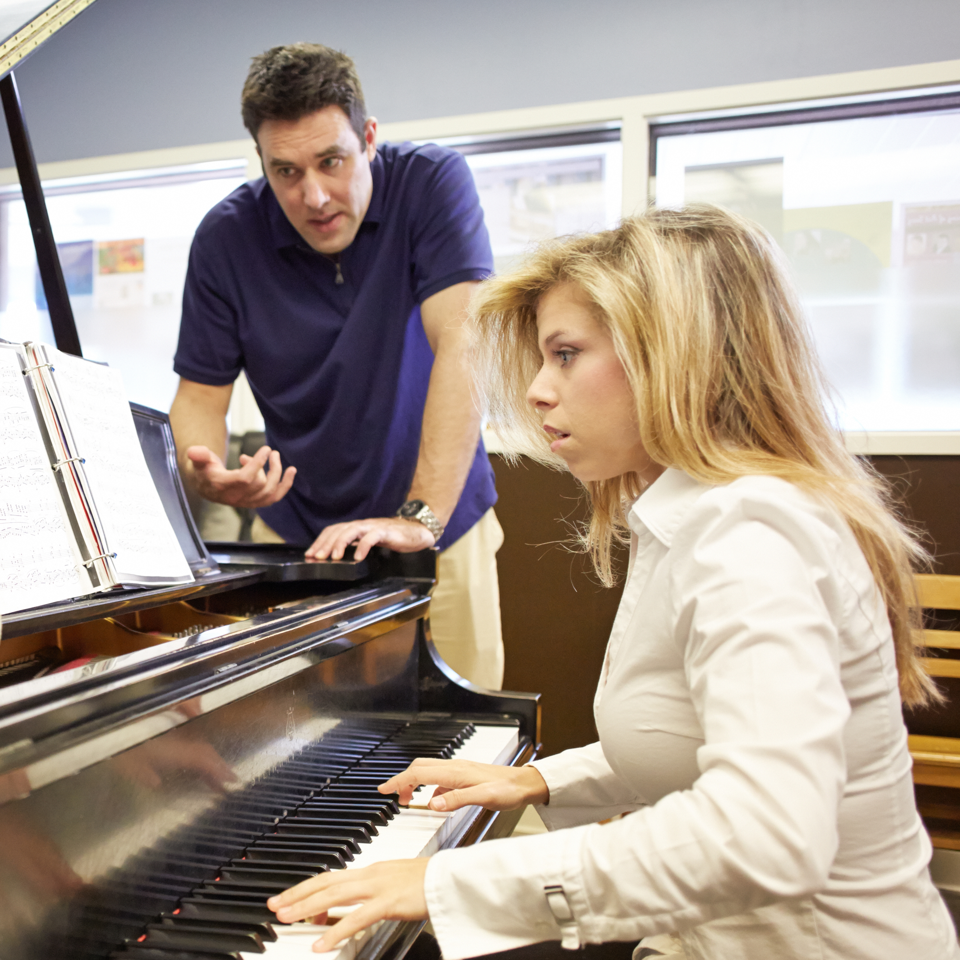 Piano professor Dr. Jonathan Korth teaches a piano student in his studio.