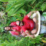 Kalamaʻehu and Keola Rick enjoying the bath at Kapuna Farms