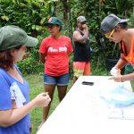 Kiana Frank demonstrating how to collect samples at Kapuna farm