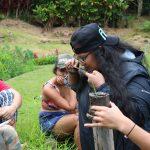 Kilo: Maluhia Low smelling a layer of loʻi mud