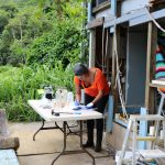 Dr. Kiana Frank tests dirt and water samples in her make shift lab at Kapuna Farms