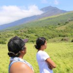 Two students looking up at Haleakalā