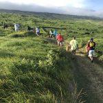 Students walking up a path in Kahikinui, Maui