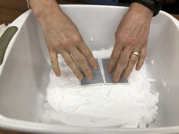 <p>Fig. 2. An example of plate movement model. What will happen to the shaving cream layer when the cards move apart? What about when they move together?</p>