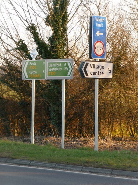 <p>Fig. 2. Road signs use patterns and colors to give information to drivers. These signs are located in&nbsp;Sturminster Marshall, England.</p>