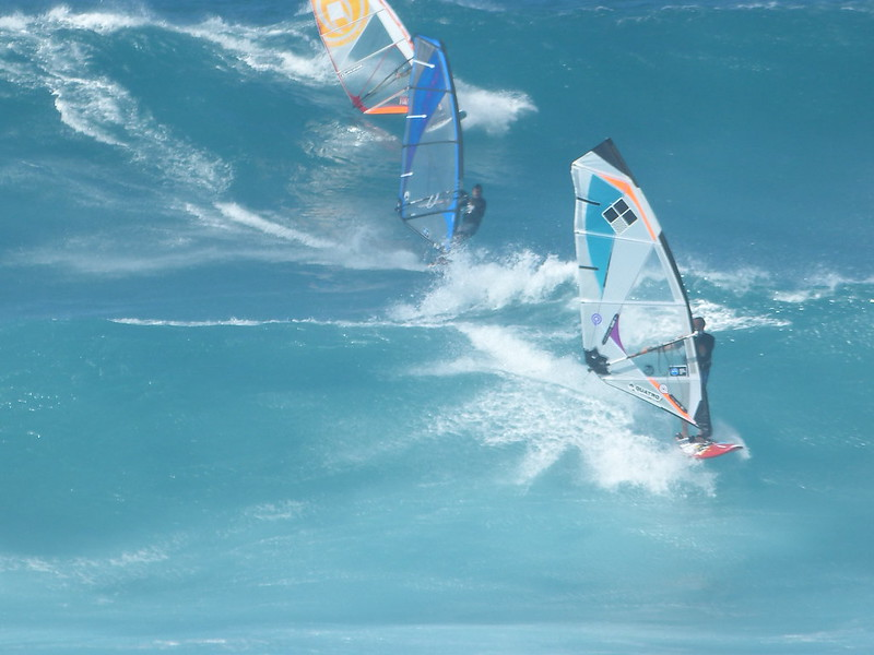 <p>Fig. 8. These wind surfers off Molokaʻi must pay particular attention to wind conditions as it influences their speed and wave conditions.</p>