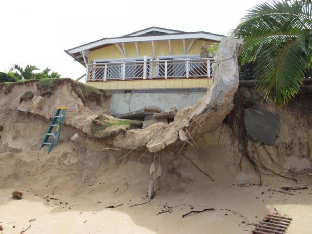 <p>Fig. 2.&nbsp;Intense waves and high sea level events contribute to coastal erosion, which threatened this house on the North Shore of O'ahu.</p><br />