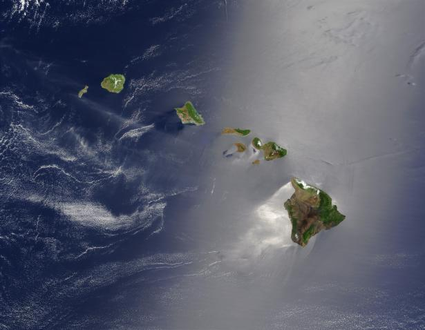 <p>Fig. 1. The Hawaiian Islands as seen from space on May 27, 2003. Notice that the East-facing (windward) sides of the islands are green. The West-facing (leeward) sides of the islands are more brown and dry.</p><br />